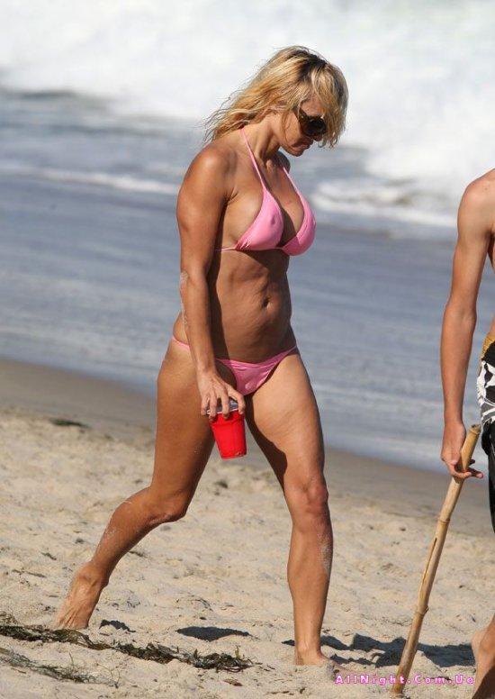 фото на пляже держит член